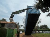The container is unloaded in Uganda.
