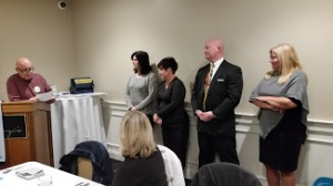 President Frank leads the Induction Ceremony for new members Ann Tinnirella, Gerogianna Kotsironis, Dan Cotnoir and Lisa Benoit.